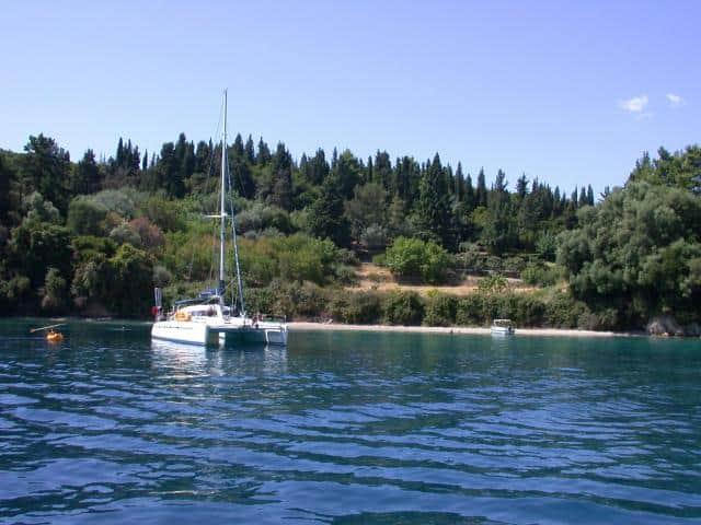Anchoring a catamaran in a nice bay.