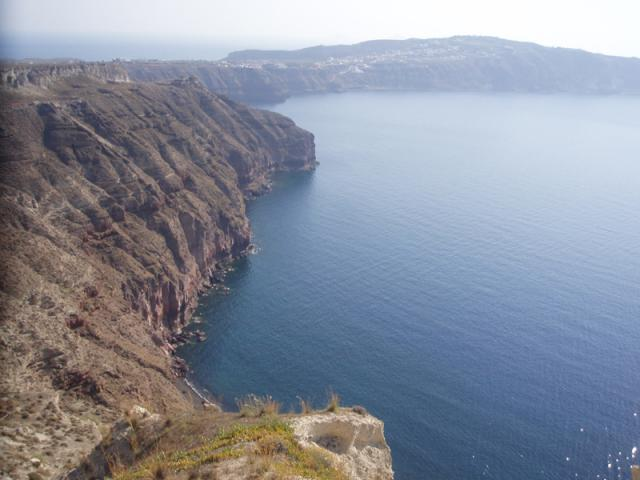 Santorini was geologically created by a series of volcanic eruptions which affected the whole Aegean. Caldera sight from Megalochori village in Santorini island.