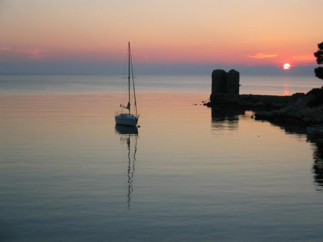 Sailing yacht during sunset in Skyros island.
