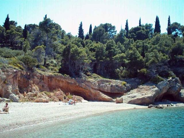 Spetses features several sandy, pebbly beaches and coves. Here, you may view Ligoneri beach.