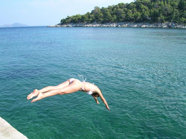 Alonissos is mainly island for relaxing so do not expect too much! Taking a dive in one of Alonnisos beautiful bays.