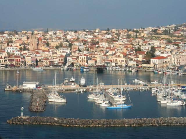 The capital and harbour of the island is the town of Aegina. View of Aigina town and port.