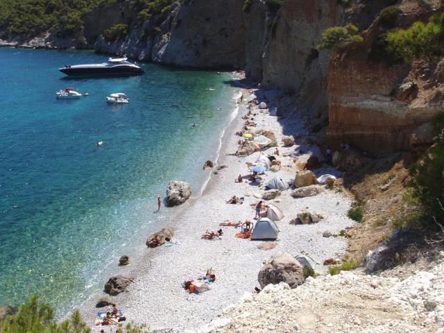 Luxury motor yacht anchored in Chalikiada beach/ Agistri, Greece.